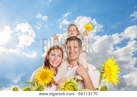 blue sky family in sunflower field