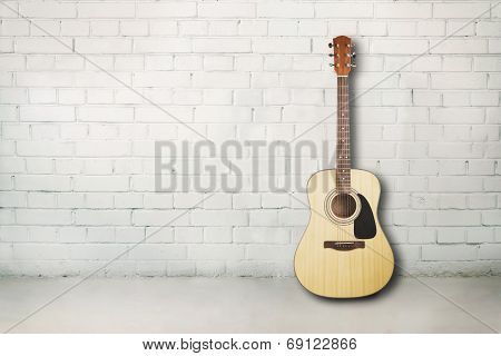 Acoustic guitar in room