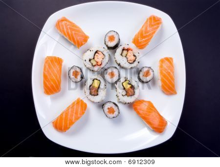 Sushi plate on black background
