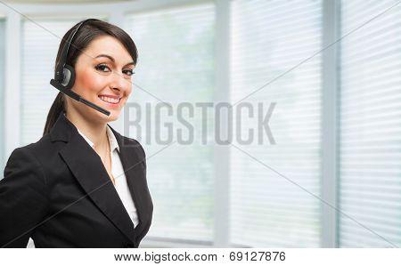 Portrait of a beautiful woman wearing an headset