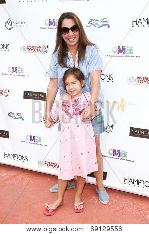 BRIDGEHAMPTON, NY-JUL 19: Hamptons magazine Editor-in-Chief Samantha Yanks & daughter Sadie attend the Family Fair at Children's Museum of East End (CMEE) on July 19, 2014 in Bridgehampton, New York.