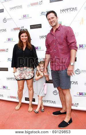 BRIDGEHAMPTON, NY-JUL 19: (L-R) Tiffani Thiessen, Harper Smith & Brady Smith attend the 6th Annual Family Fair at Children's Museum of the East End (CMEE) on July 19, 2014 in Bridgehampton, New York.