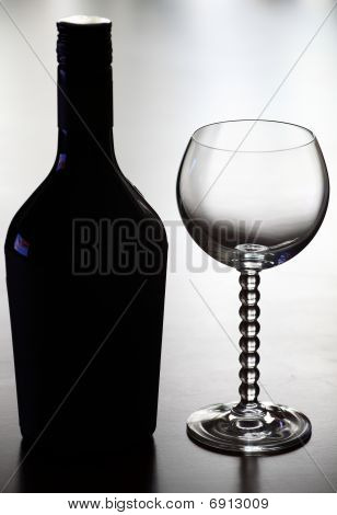 Bottle of wine and glass