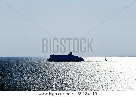 Ocean Liner And Sail boat In Baltic Sea In Evening