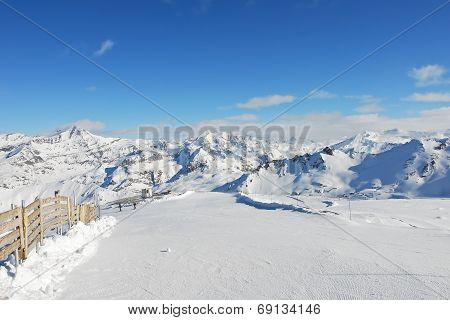 Skiing Road On Mountain Snow Slope In Paradiski Region