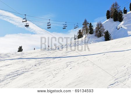 Ski Lift And Slope Of Dolomites Mountains