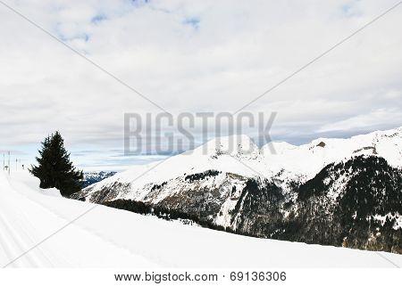 Skiing Run On Snow Mountains In Alps