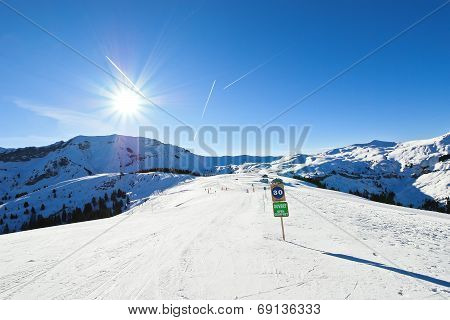 Skiing Tracks On Snow Slopes In Sunny Day