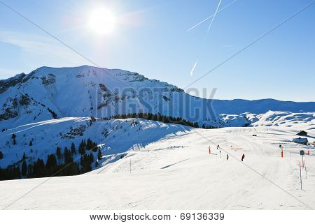 Downhill Skiing On Snow Slopes In Sunny Day