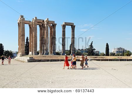 Tourist Near Ruins Of Temple Of Zeus In Athens