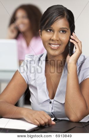 Beautiful Young Indian Asian Businesswoman On Cell Phone