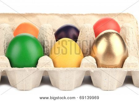 Colorful Easter Eggs in box.
