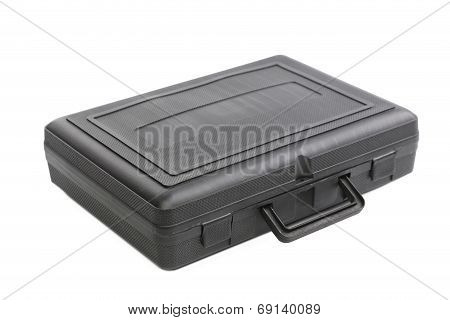 Closed black plastic case.