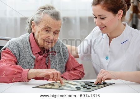 Senior Woman Playing Checkers