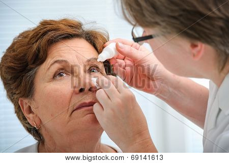 Senior Woman Applying Eye Drops