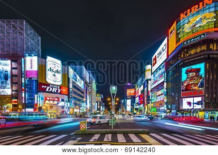 SAPPORO, JAPAN - OCTOBER 17, 2012: Traffic passes through the Susukino District. Susukino is one of the three major red-light districts within Japan.
