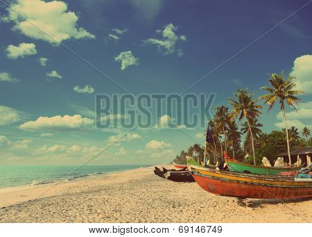 old fishing boats on beach in kerala india - vintage retro style