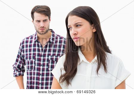 Angry brunette not listening to her boyfriend on white background