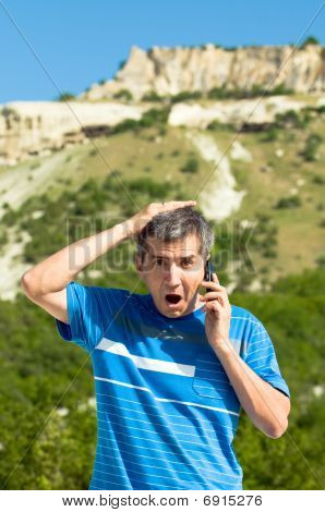 Shocked man in the mountains