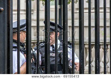 London Policemen Behind A Barrier (like in jail)