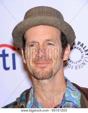 LOS ANGELES - MAR 28:  Denis O'Hare arrives to the Paleyfest 2014: American Horror Story COVEN  on March 28, 2014 in Hollywood, CA