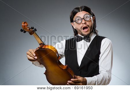 Funny fiddle violin player in musical concept