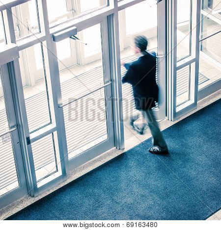 Man walking out of a business office