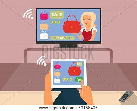Multiscreen interaction. Woman is purchasing red bag online in TV shop using tablet pc