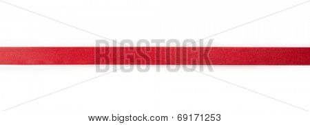 Extending simple red ribbon, isolated on white.