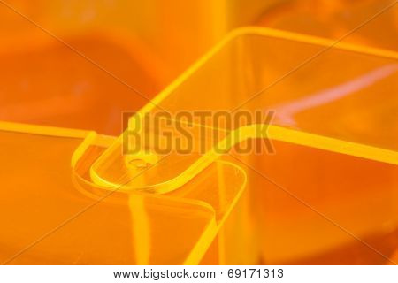 Orange acrylic or plastic hinge abstract background.