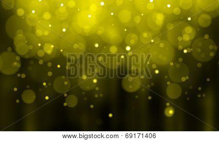Defocused gold sparkle glitter lights background. Highlighted glitter bokeh background