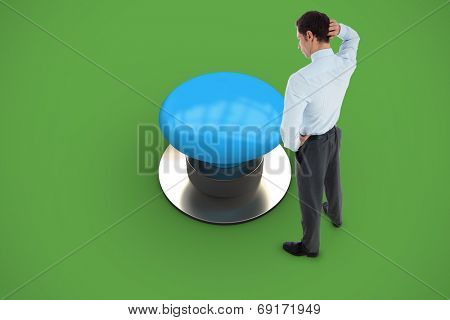 Thinking businessman scratching head against green background