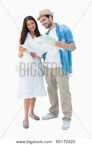 Happy hipster couple looking at map on white background