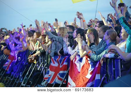People crowd with british flags
