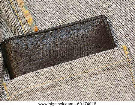 Leather purse out of denim jacket's close up