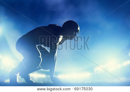 American football player in game. Night stadium lights