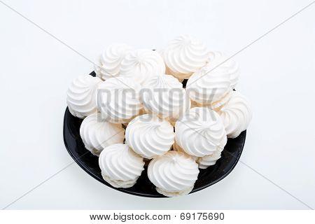 French vanilla meringue cookies on white background