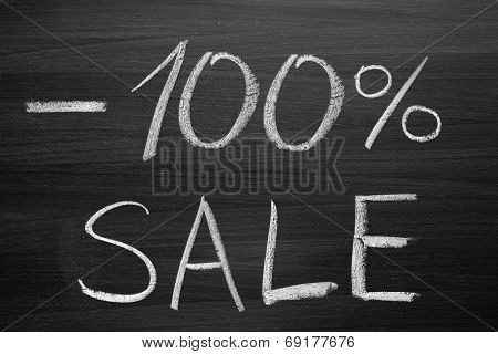 100-percent sale title written with a chalk on the blackboard