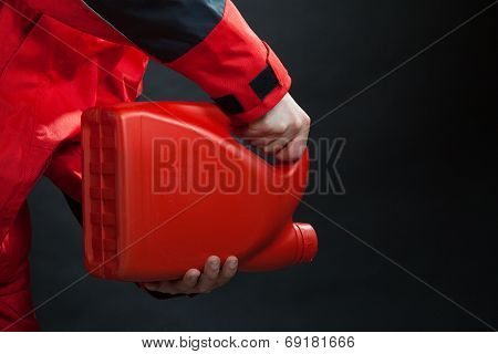 Worker Of Gas Station With Petrol Canister Oil Can