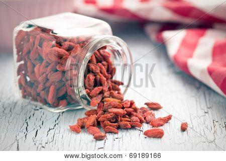 dried goji berries in glass jar