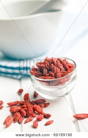 dried goji berries on white table