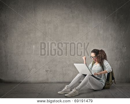 adolescent solving a problem on a laptop