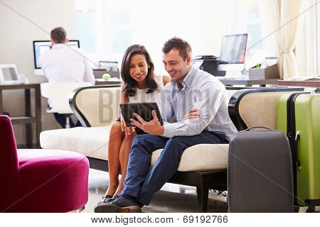 Two Businesspeople Having Meeting In Hotel Lobby