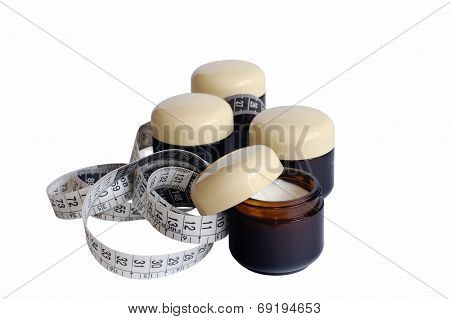 Containers With Cosmetic Cream And Measuring Tape