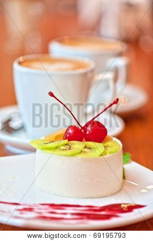 tasty fruit dessert with cherry and kiwi with coffee