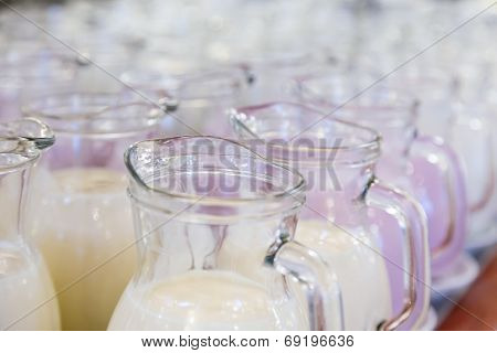 Many Glass Jugs With Milk And Yogurt