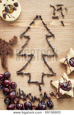 Christmas Tree Of Cloves With Rose Hips And Linzer Cookies