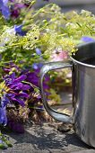 pic of ferrous metal  - metal handle tourist mugs with purple and white flowers on wooden table - JPG