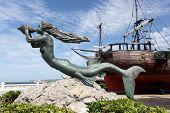 foto of historical ship  - Mermaid sculpture at historic sailing ship in Santander Cantabria Spain - JPG