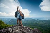 picture of selfie  - Two hikers taking selfie on top of the mountain - JPG